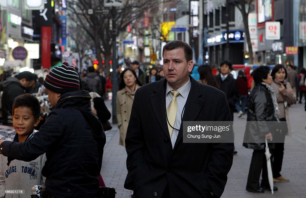 A foreign business man walks in the Myungdong shopping district on April 11, 2013 in Seoul, South Korea. According to reports a North Korean missile launcher has been moved into firing position as the continuing threats of attack emit from Pyongyang. G8 leaders have convened in London to discuss the situation.