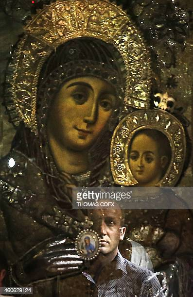 A foreign Christian worshiper waits to pray in front of icons at the Church of the Nativity revered as the site of Jesus Christ's birth in the West...
