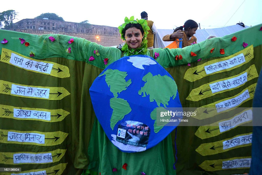 A foreign devotee taking part in a fancy dress to drive home the message of environment protection as part of special prayers organized by members of Ganga action plan, in the Kumbh Mela area, on February 19, 2013 in Allahabad, India. The next and second last official bathing of Maha Kumbh 2013 is set to take place on 'Maghi Purnima' on February 25.