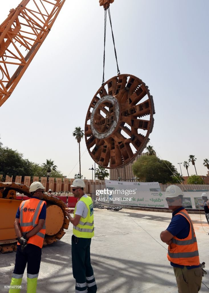 Foreign engineers work on May 4, 2016 at a construction site of a section of the Saudi capital Riyadh's $22.5 billion metro system. The system, which will have six lines covering 176 kilometres (109 miles), supported by a bus network of 1,150 kilometres, is due to be completed by the end of 2018. Deputy Crown Prince Mohammed bin Salman announced a long-term reform programme, dubbed 'Vision 2030', marking the beginning of a hugely ambitious attempt to move Saudi Arabia beyond oil, the backbone of its economy for decades. / AFP / FAYEZ