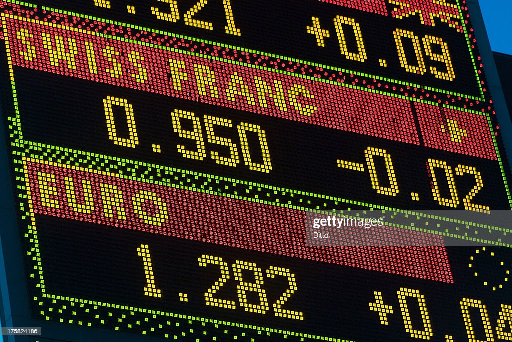 Foreign exchange display, Swiss Franc and Euro : Stock Photo