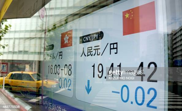 A foreign exchange rate board against the Chinese yuan is displayed in Tokyo on August 13 2015 Tokyo stocks closed 099 percent higher August 13...