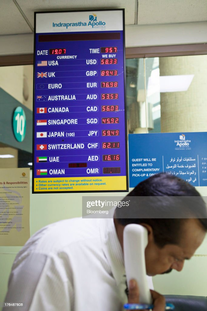 Foreign exchange rates are displayed at a currency exchange counter in the International Patients Lounge of the Indraprastha Apollo Hospitals facility, operated by Apollo Hospitals Enterprise Ltd., in New Delhi, India, on Wednesday, July 19, 2013. Prathap C. Reddy, the cardiologist who built the Apollo hospital chain valued at $2 billion over three decades in India, says hes seeking growth overseas as the nations visa policies drive medical tourists to rivals. Photographer: Prashanth Vishwanathan/Bloomberg via Getty Images