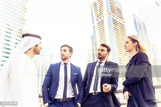 Foreign Executives discussing business with an Emirati