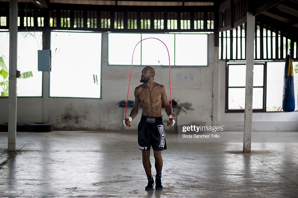 A foreign fighter jumps rope before his fight at Klong Pai prison on July 12, 2014 in Nakhon Ratchasima, Thailand. Prison Fight is an sport event which takes place in different prisons in Thailand and involves inmates fighting against foreign fighters looking for their rehabilitation, to promote the sport and good health among prisoners and to help them with better social adaptation for the future. Thailand has a strong tradition in fight sports such as Muay Thai and boxing, and inmates can reduce their jail sentence fighting in this event organized between World Prison Fight Association (WPFA) with the assistance of the Department Of Corrections.