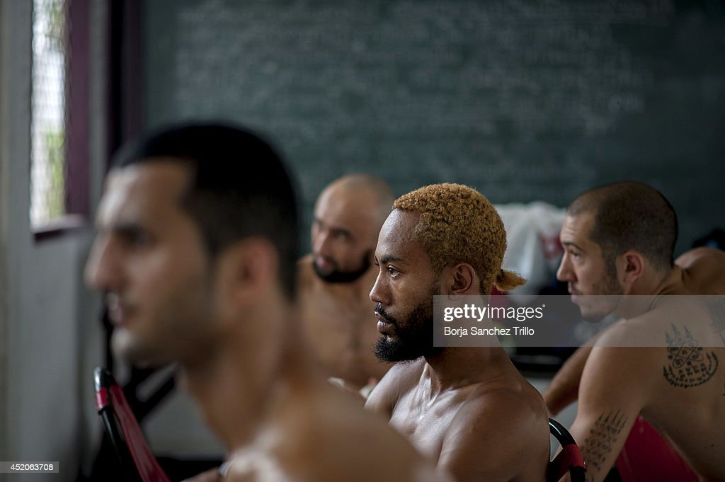 Foreign fighters watch a Muay Thai fight before they take part in their fights at Klong Pai prison on July 12, 2014 in Nakhon Ratchasima, Thailand. Prison Fight is an sport event which takes place in different prisons in Thailand and involves inmates fighting against foreign fighters looking for their rehabilitation, to promote the sport and good health among prisoners and to help them with better social adaptation for the future. Thailand has a strong tradition in fight sports such as Muay Thai and boxing, and inmates can reduce their jail sentence fighting in this event organized between World Prison Fight Association (WPFA) with the assistance of the Department Of Corrections.
