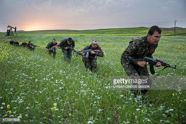 Foreign fighters who joined the Kurdish People's Protection Units to fight in their ranks against jihadists and Islamist rebels in northeastern Syria...