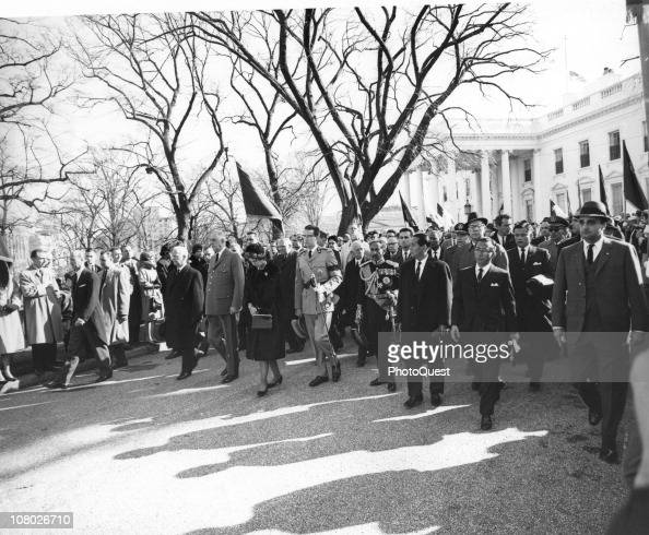 Foreign heads of state and other dignitaries follow the Kennedy family in the funeral procession for assassinated President John F Kennedy as it...