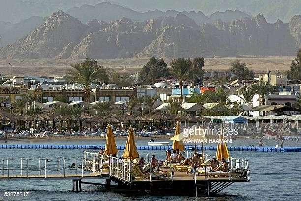 Foreign holiday makers take advantage of the summer weather 04 January 2004 as they sun bath along the shore in the Egyptian Red Sea resort of Sharm...