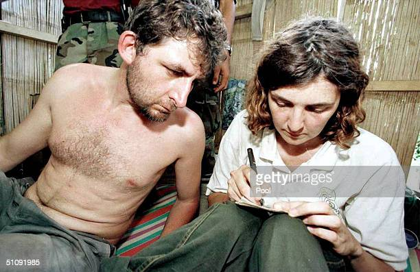 Foreign Hostages Sonia Wending Of France Marie Michel Of Lebanon Marc Walleri Of Germany And Juhani Franti Seppo Of Finland Sit In A Shack May 1 2000...