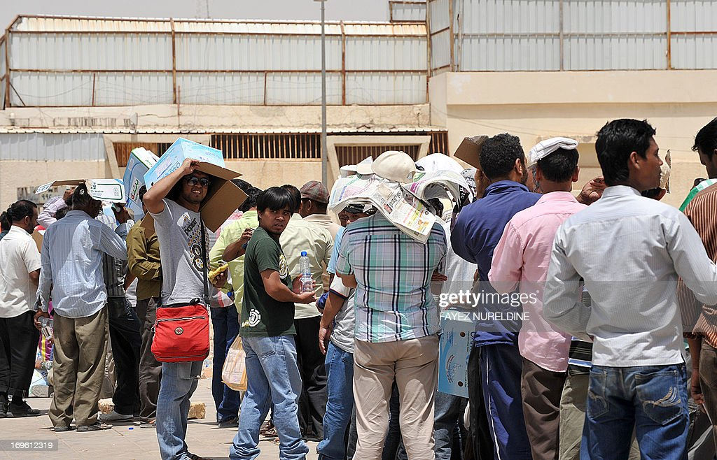 Foreign illegal laborers wait in a long queue outside the Saudi immigration offices at the Al-Isha quarter of the Al-Khazan district, west of Riyadh, on May 28, 2013. Saudi authorities imposed new regulations on foreign workers to limit irregularities and launched a deporting campaign of hundreds of thousands illegal foreign workers, to try to reduce unemployment rates among its own citizens, as more than 8 million foreigners have residency in the booming kingdom's economy.
