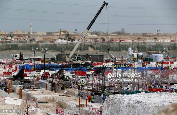 Foreign laborers work at the construction site of the alWakrah football stadium one of the Qatar's 2022 World Cup stadiums on May 4 in Doha's...