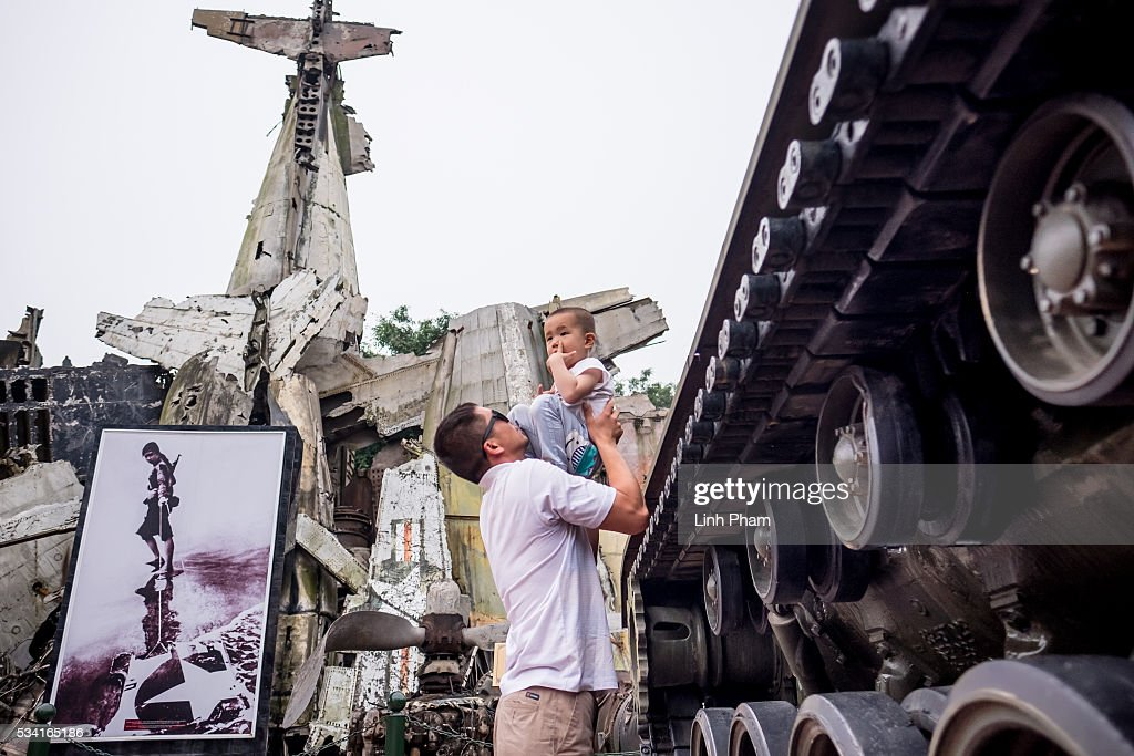 A foreign man and child play with each others on the site of Vietnam Military History Museum on May 25, 2016 in Hanoi, Vietnam. U.S. President Obama made his historic visit to Vietnam on May 23 with an aim to strengthen the strategic and economic relationship between both countries four decades after the Vietnam war. During the visit, Obama announced the U.S. will fully lift its embargo on weapons and raised issues related to human rights while speaking to the youths on freedom of expression.