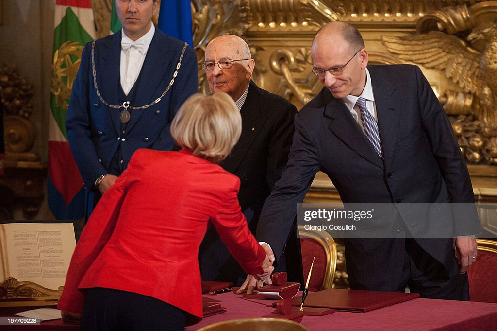 Foreign Minister <a gi-track='captionPersonalityLinkClicked' href=/galleries/search?phrase=Emma+Bonino&family=editorial&specificpeople=539913 ng-click='$event.stopPropagation()'>Emma Bonino</a> (CL) shakes hand with Italy's new Prime Minister <a gi-track='captionPersonalityLinkClicked' href=/galleries/search?phrase=Enrico+Letta&family=editorial&specificpeople=2915592 ng-click='$event.stopPropagation()'>Enrico Letta</a> (R) during the swearing in ceremony of the new government at Quirinale palace on April 28, 2013 in Rome, Italy. The new coalition government was formed through extensive cooperation agreements between the right and left coalitions, after a two-month long post-election deadlock.