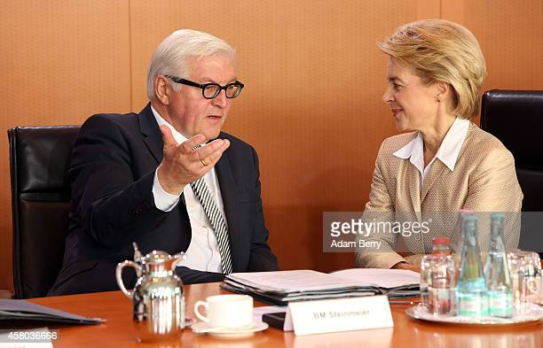 Foreign Minister FrankWalter Steinmeier and Defense Minister Ursula von der Leyen arrive for the weekly German federal Cabinet meeting on October 29...
