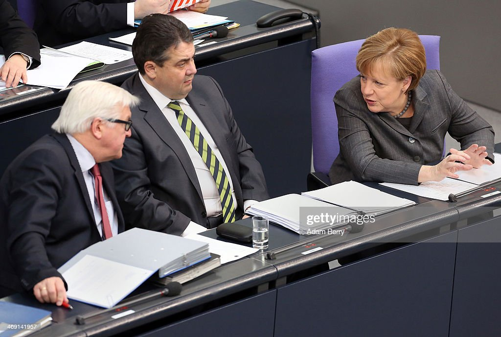 Foreign Minister <a gi-track='captionPersonalityLinkClicked' href=/galleries/search?phrase=Frank-Walter+Steinmeier&family=editorial&specificpeople=603500 ng-click='$event.stopPropagation()'>Frank-Walter Steinmeier</a> (SPD), Vice Chancellor and Economy and Energy Minister <a gi-track='captionPersonalityLinkClicked' href=/galleries/search?phrase=Sigmar+Gabriel&family=editorial&specificpeople=543927 ng-click='$event.stopPropagation()'>Sigmar Gabriel</a> (SPD) and German Chancellor <a gi-track='captionPersonalityLinkClicked' href=/galleries/search?phrase=Angela+Merkel&family=editorial&specificpeople=202161 ng-click='$event.stopPropagation()'>Angela Merkel</a> arrive for a meeting of the Bundestag, or German federal Parliament, on February 13, 2014 in Berlin, Germany. In a government policy statement, or Regierungserklaerung, Gabriel said he wants to see more financial strengthening of German cities and local communities, as well as an 8.50 EUR an hour minimum wage, a proposal met with opposition by Sahra Wagenknecht of the Left party (Die Linken), who insisted that 10 EUR an hour is a fairer salary.