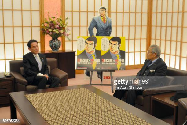 Foreign Minister Fumio Kishida and manga artist Takao Saito hold their meeting at the Foreign Ministry on March 22 2017 in Tokyo Japan