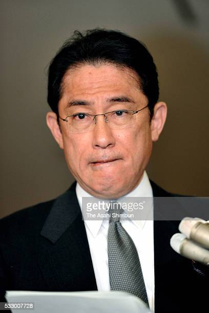 Foreign Minister Fumio Kishida speaks to media reporters after summoning the US Ambassador to Japan Caroline Kennedy to protest after a US military...