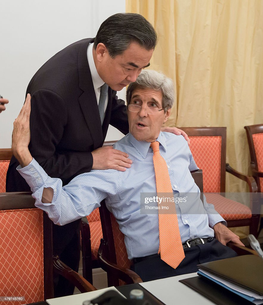 US Foreign Minister <a gi-track='captionPersonalityLinkClicked' href=/galleries/search?phrase=John+Kerry&family=editorial&specificpeople=154885 ng-click='$event.stopPropagation()'>John Kerry</a> (R) speaks to <a gi-track='captionPersonalityLinkClicked' href=/galleries/search?phrase=Wang+Yi+-+Pol%C3%ADtico&family=editorial&specificpeople=13620429 ng-click='$event.stopPropagation()'>Wang Yi</a>, Foreign Minister of China during the nuclear talks between the E3+3 (France, Germany, UK, China, Russia, US) and Iran on July 07, 2015 in Vienna, Austria. Negotiators with USA, Britain, China, France, Germany and Russia are meeting with Iran to finalize an interim deal over Iran's nuclear program. Photo by Thomas Imo/Photothek via Getty Images)