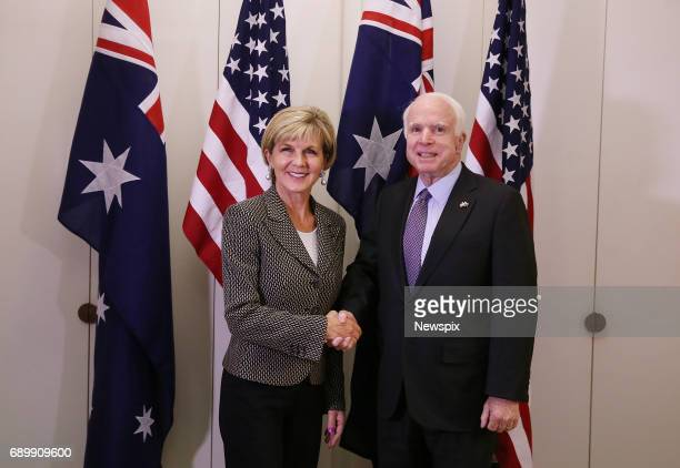 CANBERRA ACT Foreign Minister Julie Bishop shakes hands with Senator John McCain at Parliament House in Canberra Australian Capital Territory Senator...