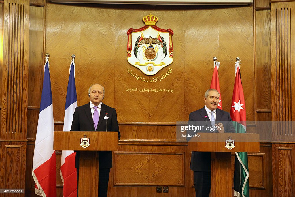 Foreign Minister of France <a gi-track='captionPersonalityLinkClicked' href=/galleries/search?phrase=Laurent+Fabius&family=editorial&specificpeople=540660 ng-click='$event.stopPropagation()'>Laurent Fabius</a> (L) holds a press conference with his Jordanian counterpart <a gi-track='captionPersonalityLinkClicked' href=/galleries/search?phrase=Nasser+Judeh&family=editorial&specificpeople=3465453 ng-click='$event.stopPropagation()'>Nasser Judeh</a> upon his arrival for talkson July 19, 2014, in Amman, Jordan.