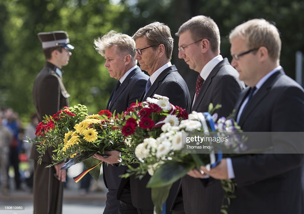Foreign Minister of Lithuania Audronius Azubalis, German Foreign Minister Guido Westerwelle, Foreign Minister of Latvia Edgars Rinkevics and Minister of Foreign Affairs of Estonia Urmas Paet lay down flowers at the liberty monument on August 23, 2012 in Riga, Latvia. The ministers take part in the regular political consultations between the Baltic States and Germany, the so-called 3+1 consultations.