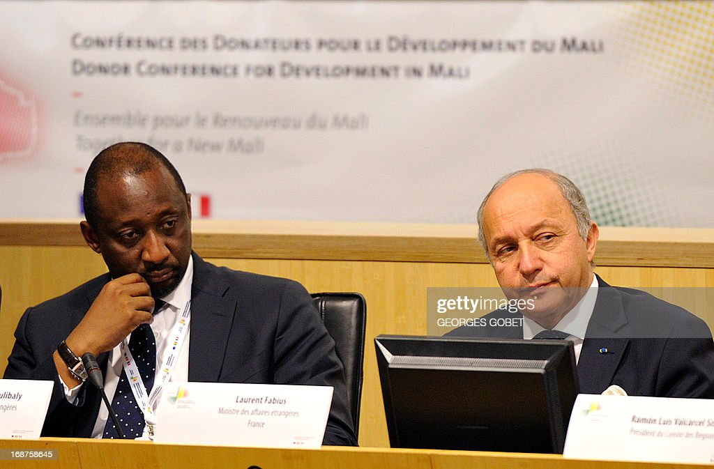 Foreign minister of Mali Tieman Coulibaly (L) and French Foreign Affairs minister Laurent Fabius (R) participate at the Donor Conference for development in Mali on May 15, 2013 at the EU Headquarters in Brussels. The EU and France will gather international donors to drum up aid and support for Mali as it seeks to move on from a war against hardline Islamists and end a two-year old political crisis. The conference will be attended by French President Francois Hollande, his Malian counterpart Dioncounda Traore, European Commission chief Jose Manuel Barroso and heads of state from several west African countries.