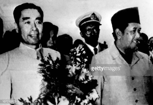 Foreign minister of People's Republic of China Zhou Enlai is welcomed by Indonesian Prime minister Aly SastoAmidjojo 18 April 1955 as he arrives at...