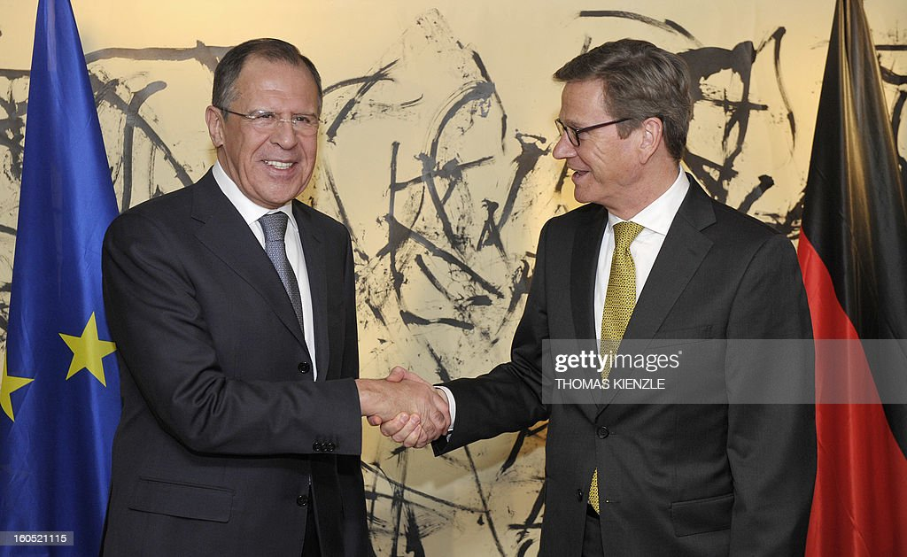 Foreign Minister of Russia, Sergey Lavrov (L) and German counterpart Guido Westerwelle shake hands on the second day of the 49th Munich Security Conference on February 2, 2013 in Munich, southern Germany as world leaders, ministers and top military gather for talks with the spotlight on Syria, Mali and Iran.