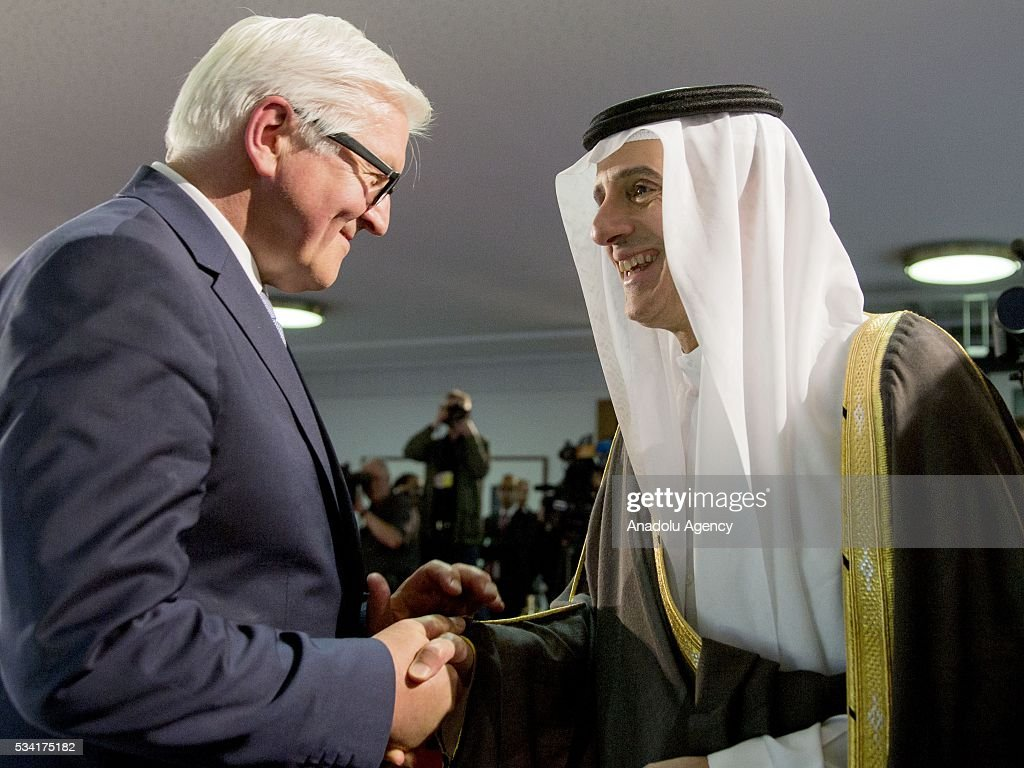Foreign Minister of Saudi Arabia Adel al-Jubeir (R) and German Foreign Minister Frank-Walter Steinmeier (L) shake hands during a press conference after their talks in Berlin, Germany on May 25, 2016.