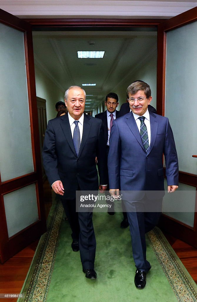 Foreign Minister of Turkey Ahmet Davutoglu (R) meets with foreign minister of Tashkent Abdulaziz Komilov (L) in Tashkent, Uzbekistan on 10 July, 2014.