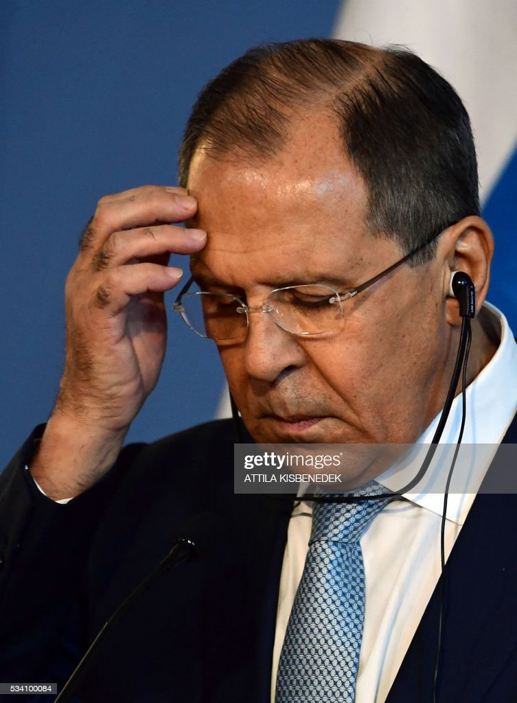 Foreign Minister Sergei Lavrov of Russia attends a press conference with his Hungarian counterpart at the ministry in Budapest on May 25, 2016. / AFP / ATTILA
