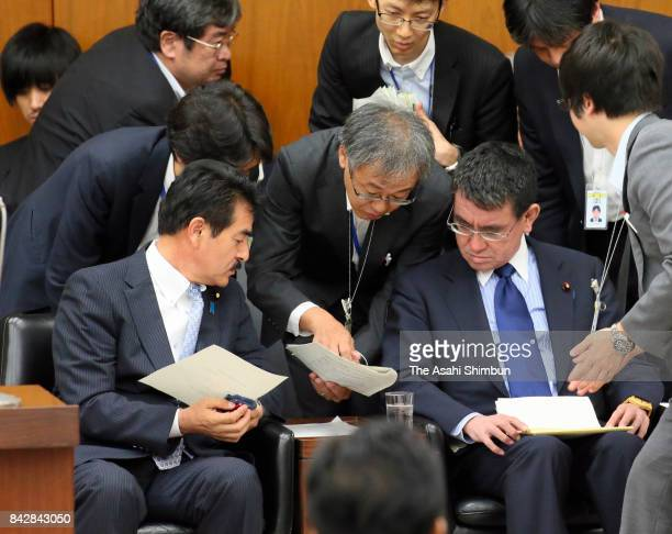 Foreign Minister Taro Kono checks with staffs prior to respond a question during an Upper House Foreign and Defense Committee at the diet building on...