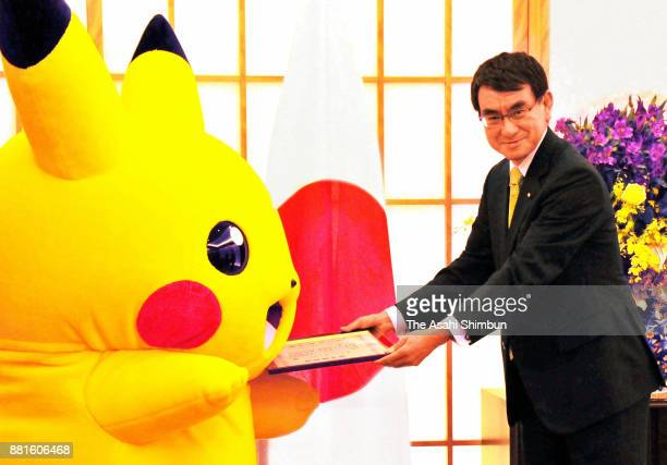 Foreign Minister Taro Kono hands an appointment letter to Pikachu during an appointment ceremony of Osaka's bidding to Expo 2025 on November 27 2017...
