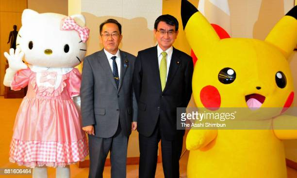 Foreign Minister Taro Kono poses with Pikachu and Hello Kitty during an appointment ceremony of Osaka's bidding to Expo 2025 on November 27 2017 in...
