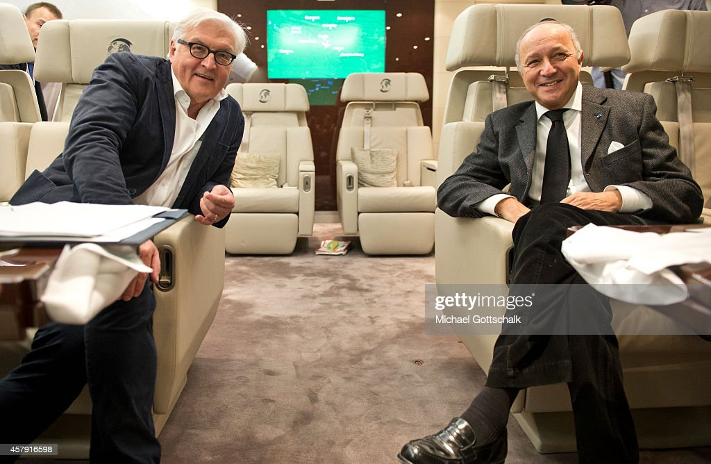 Foreign Ministers Frank-Walter Steinmeier of Germany (L) and Laurent Fabius of France chat on a German air force airplane at Orly Aiport prior their flight to Abuja, Nigeria October 26, 2014 in Paris, France. The Ministers are travelling to Nigeria to assess security concerns and the Ebola epidemic.