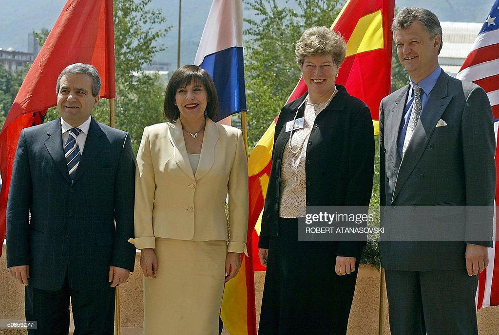 Foreign ministers from Albania, Croatia and Macedonia Kastriot Islami (L), Miomir Zuzulj (R) and Ilinka Mitreva (2nd L) pose with US diplomat Catheline Stevens during the second meeting of the Adriatic Charter, held in the Macedonian capital Skopje 20 May 2004. The Adriatic Charters is a US sponsored partnership initiative between Balkan NATO hopefuls Macedonia, Croatia and Albania.