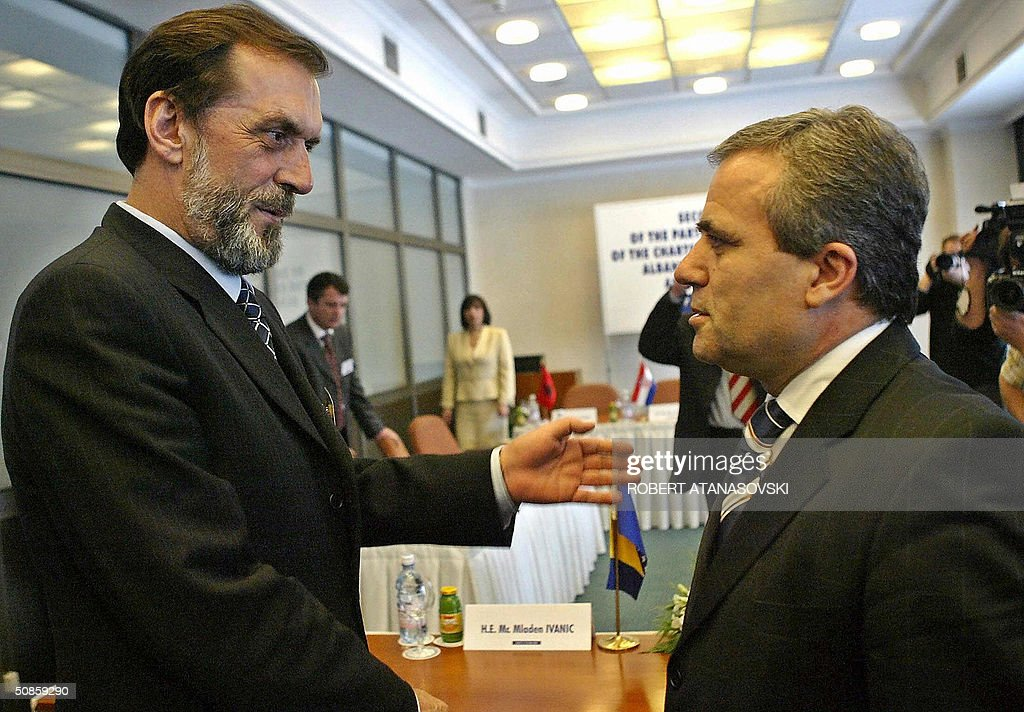 Foreign ministers Kastriot Islami (R) from Albania and Vuk Draskovic from Serbia-Montenegro meet at the second conference of the Adriatic Charter, held in the Macedonian capital Skopje 20 May 2004. The Adriatic Charters is a US sponsored partnership initiative between Balkan NATO hopefuls Macedonia, Croatia and Albania, while Draskovic had an observer role.