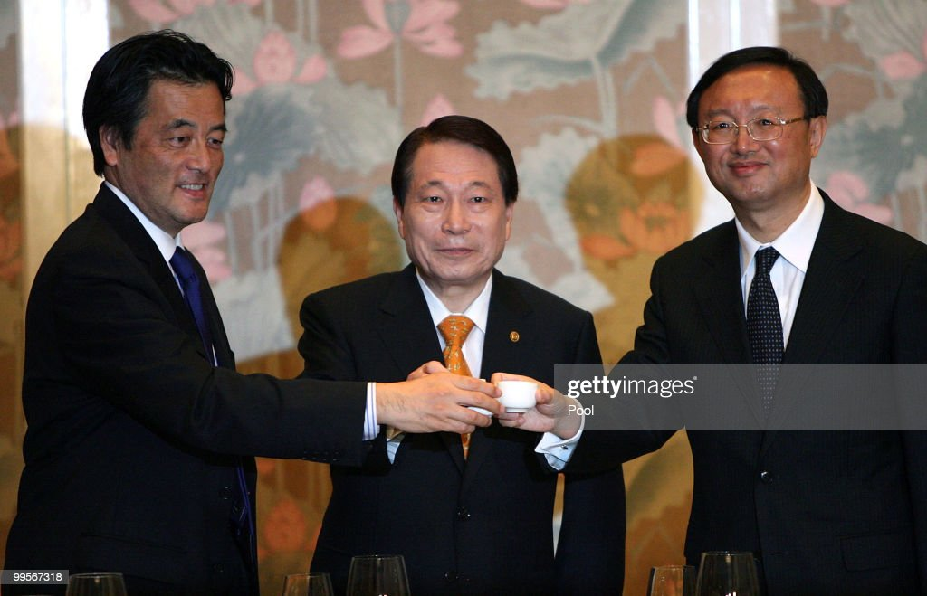 Foreign Ministers <a gi-track='captionPersonalityLinkClicked' href=/galleries/search?phrase=Katsuya+Okada&family=editorial&specificpeople=226520 ng-click='$event.stopPropagation()'>Katsuya Okada</a> of Japan, Yu Myung-hwan of South Korean and <a gi-track='captionPersonalityLinkClicked' href=/galleries/search?phrase=Yang+Jiechi&family=editorial&specificpeople=555098 ng-click='$event.stopPropagation()'>Yang Jiechi</a> of China toast during a dinner on May 15, 2010 in Gyeongju, South Korea. Foreign ministers hold talks Saturday, to discuss North Korea's nuclear drive and the recent sinking of a South Korean warship.
