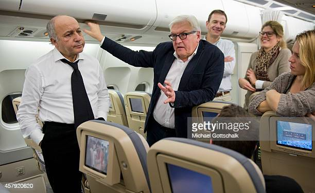 Foreign Ministers Laurent Fabius of France and FrankWalter Steinmeier of Germany chat on a German air force airplane at Orly Aiport prior their...
