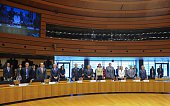 Foreign Ministers of several countries stand during a minute of silence before the strat of an emergency meeting of foreign and interior ministers in...