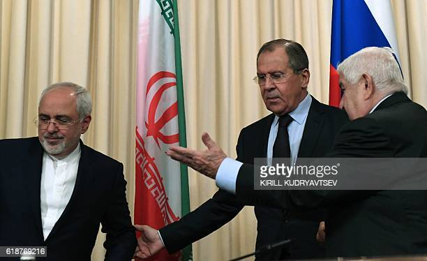 Foreign Ministers Sergei Lavrov of Russia Mohammad Javad Zarif of Iran and Walid Muallem of Syria leave a hall after a joint press conference...