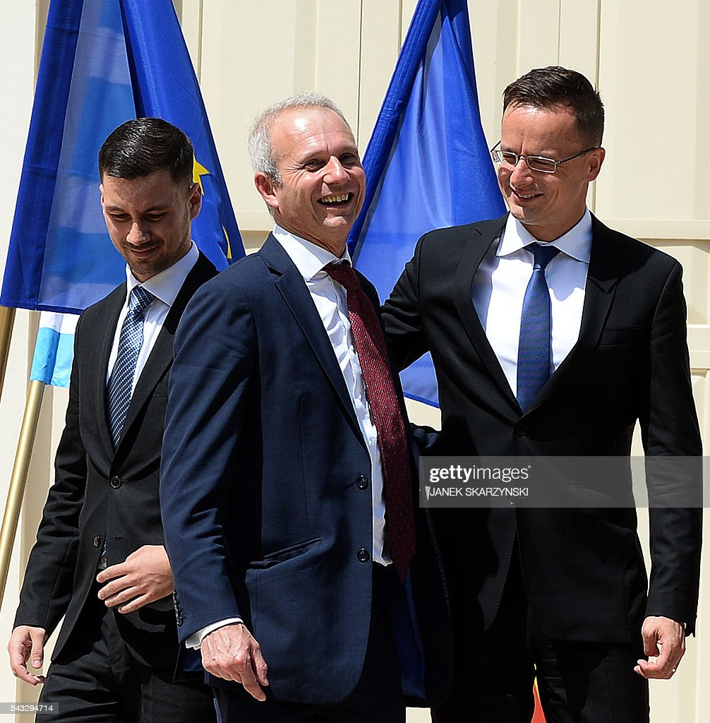 Foreign Ministry heads and officials, (L-R) Slovakia's Lukas Parizek, Great Britain's David Lidington and Hungary's Peter Szijjatro take ther places to pose for a group photo during a break in talks in Warsaw, Poland on June 27, 2016. / AFP / JANEK
