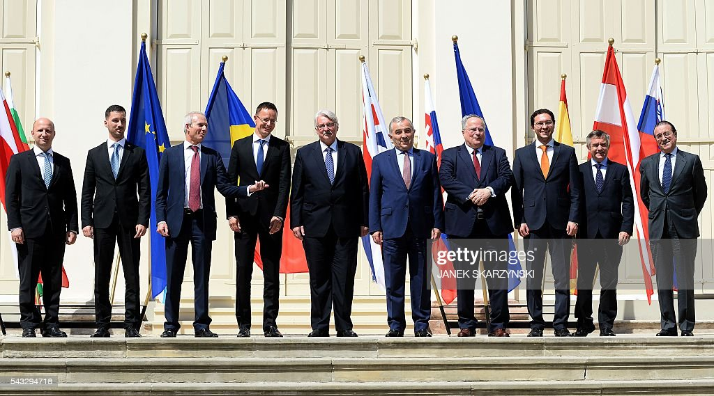 Foreign Ministry heads and officials, (L-R) Slovenia's David Brozina, Slovakia's Lukas Parizek, Great Britain's David Lidington, Hungary's Peter Szijjatro, Poland's Witold Waszczykowski, Romania's Lazar Comanescu, Greece's Nikolaos Kotzias, Bulgaria's Daniel Mitov, Austria's Hubert Heiss and Spain's Fernando Eguidazu Palacios pose for a group photo during a break in talks in Warsaw, Poland on June 27, 2016. / AFP / JANEK
