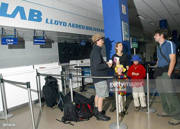 Foreign nationals remain stranded 18 October 2003 at El Alto international airport 12 km from La Paz waiting for flights to leave the country Former...