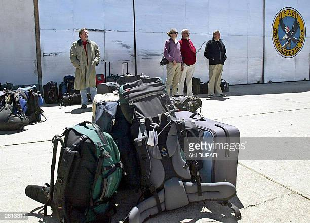Foreign nationals remain stranded 18 October 2003 in the military sector of El Alto international airport 12 km from La Paz waiting to be evacuated...