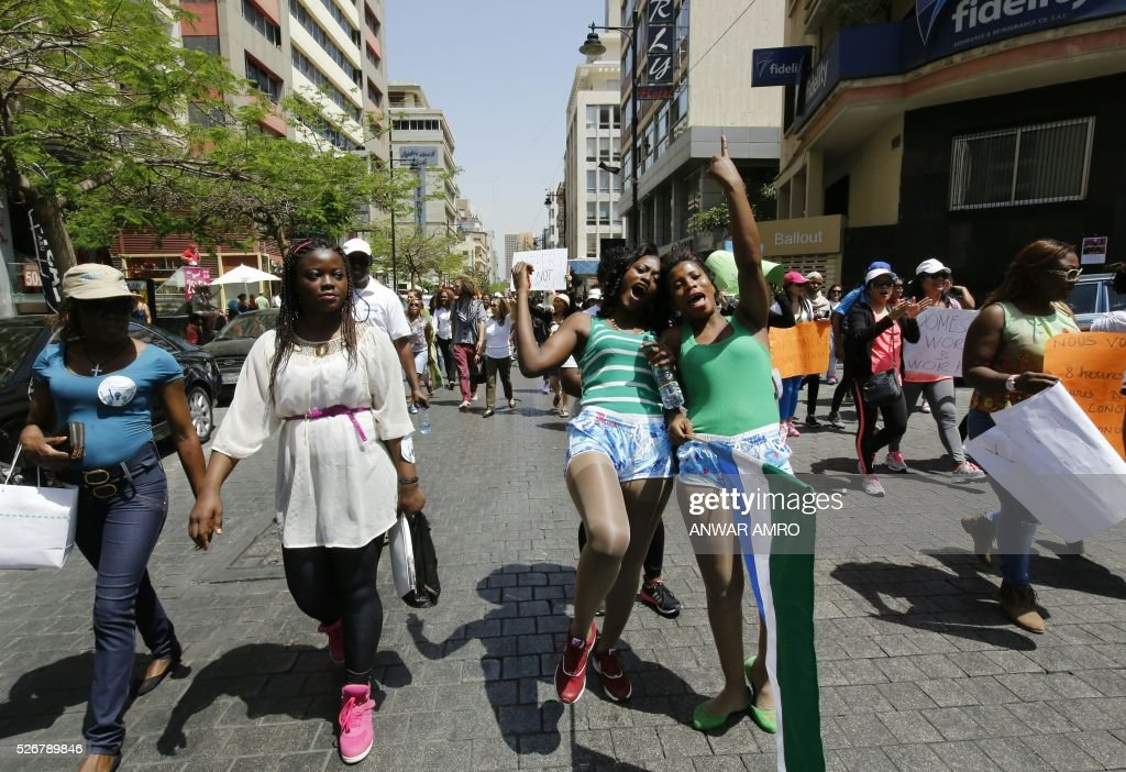 Foreign nationals working as domestics workers take part in a parade to mark May Day and to highlight their plight on May 1, 2016, in the Lebanese capital Beirut. / AFP / ANWAR