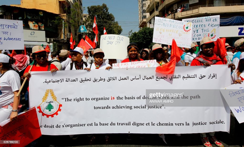 Foreign nationals working as domestics workers take part in a rally organised by the Lebanese Communist party and marking May Day on May 1, 2016, in the capital Beirut. / AFP / ANWAR