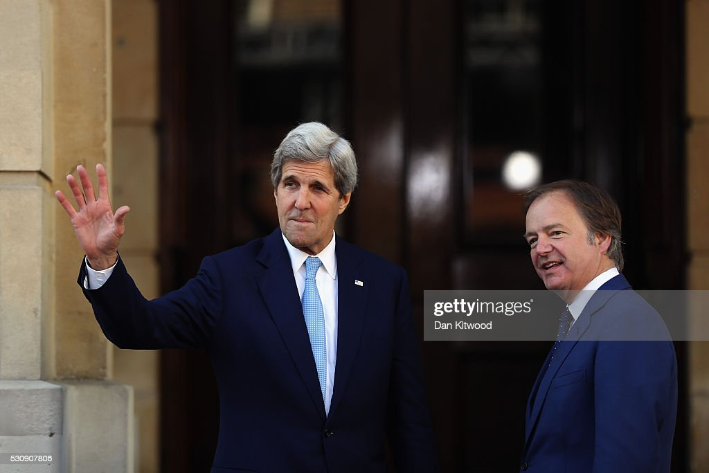 Foreign Office Minister Hugo Swire greets US Secretary of State John Kerry arrives at Lancaster House for the international anticorruption summit on...
