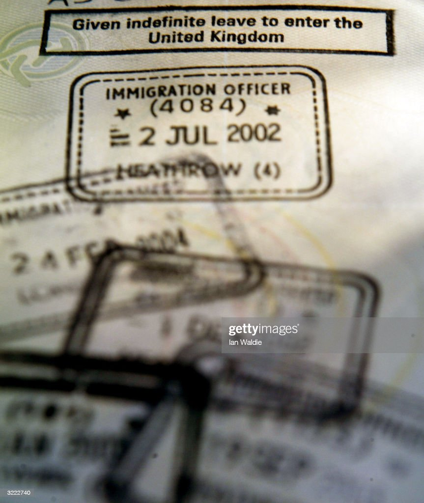 A foreign passport is stamped with the coveted 'Indefinite leave to enter the United Kingdom' permit is displayed April 6, 2004 in Croydon, England. British Prime Minister Tony Blair will today host a crisis summit on immigration with senior government colleagues following speculation surrounding the resignation of immigration minister Beverley Hughes last week.